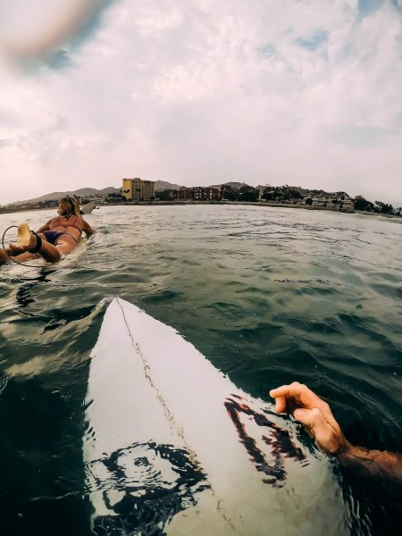 Surfing at Surfers Point with couple