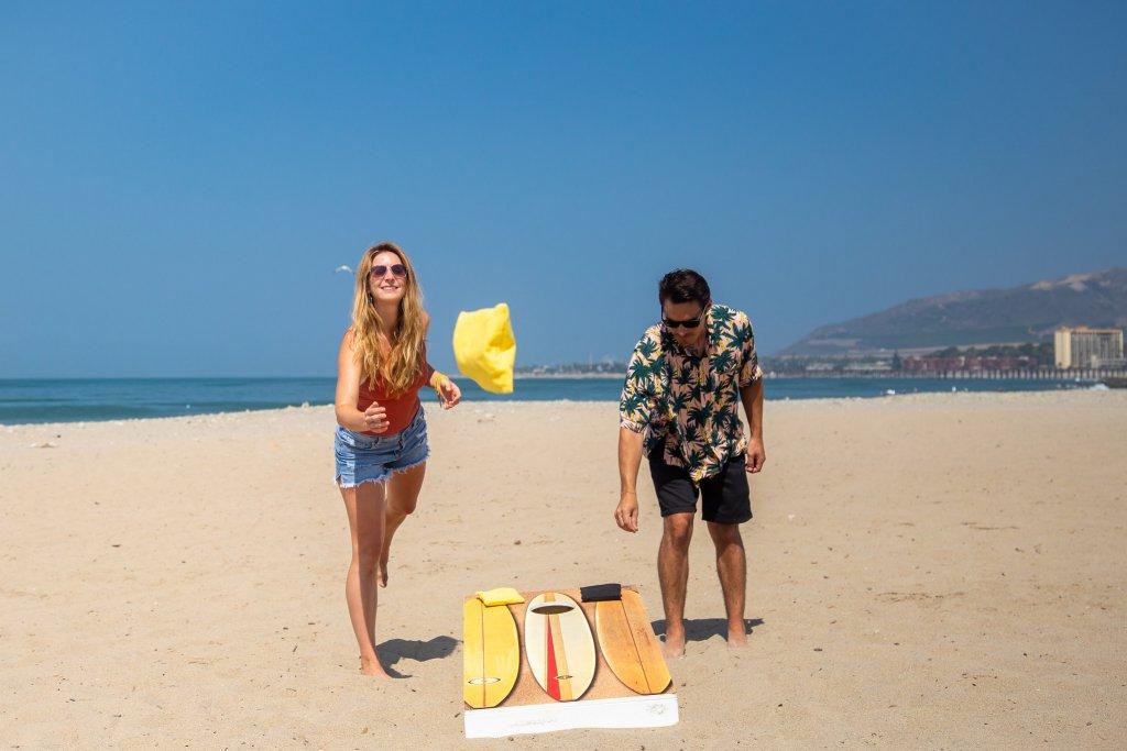 Jessy and friend playing cornhole at state beach