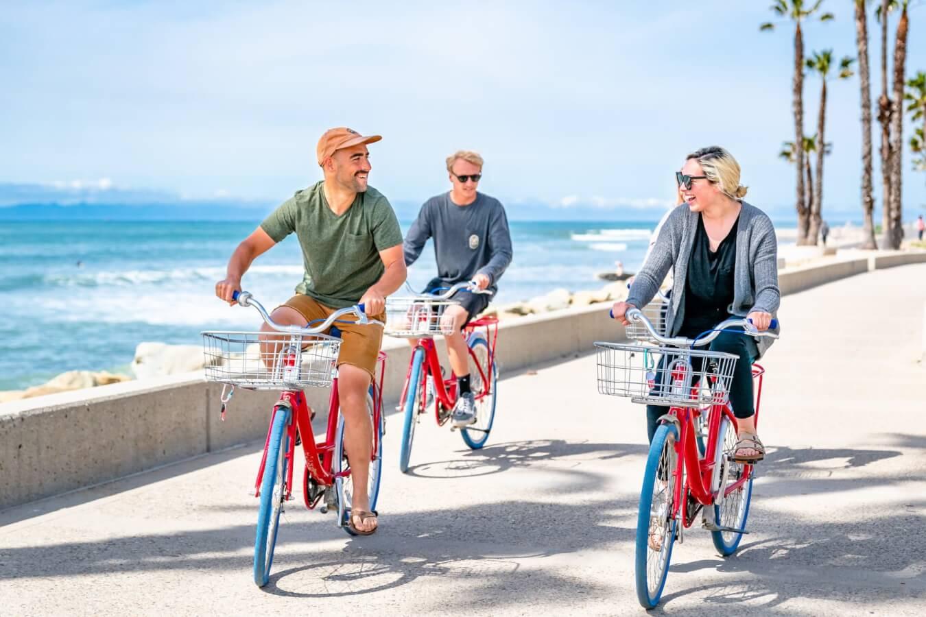 Friends riding bikes at surfers point ventura