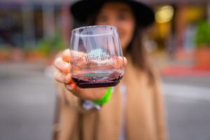 Woman Holding up Wine Glass at Ventura Winter Wine Walk