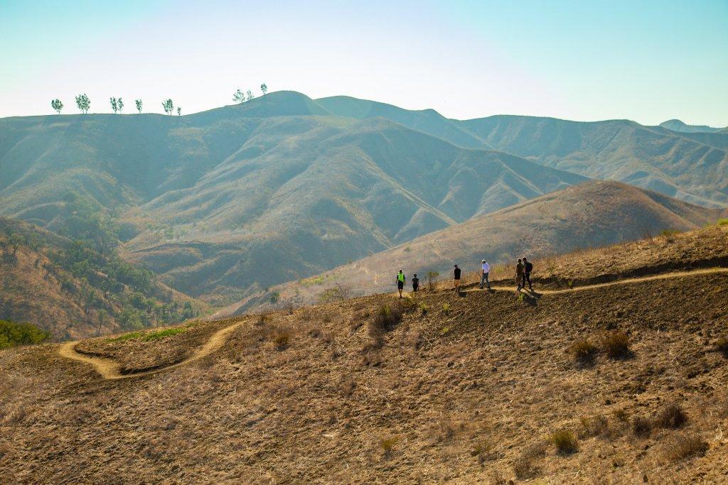 Group hiking down harmon canyon