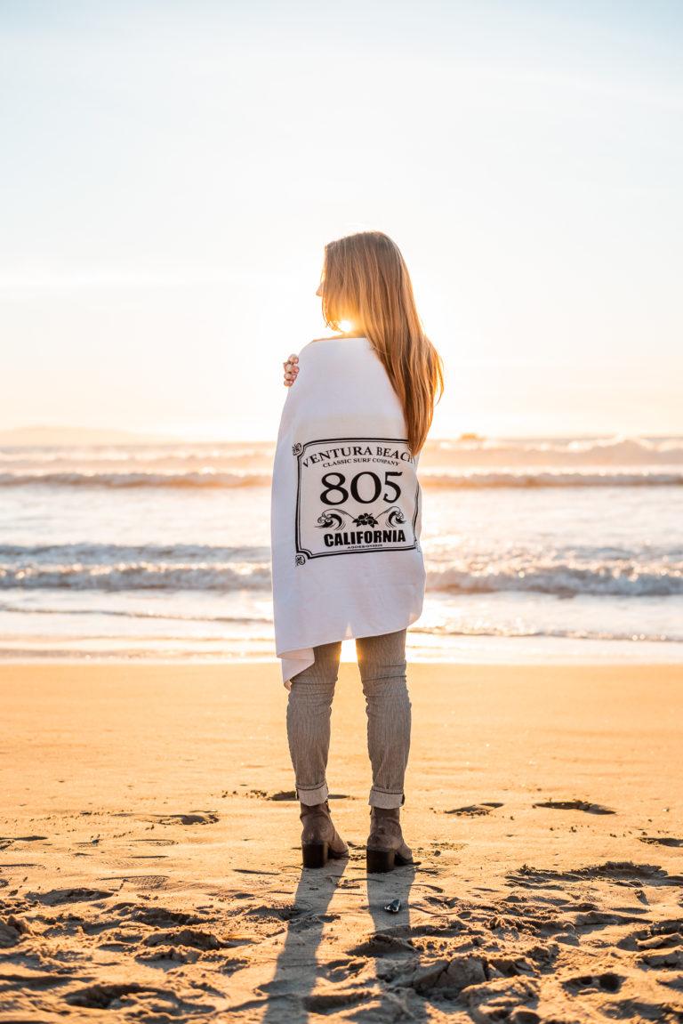 Woman Wearing 805 Beach Towel at Ventura Harbor