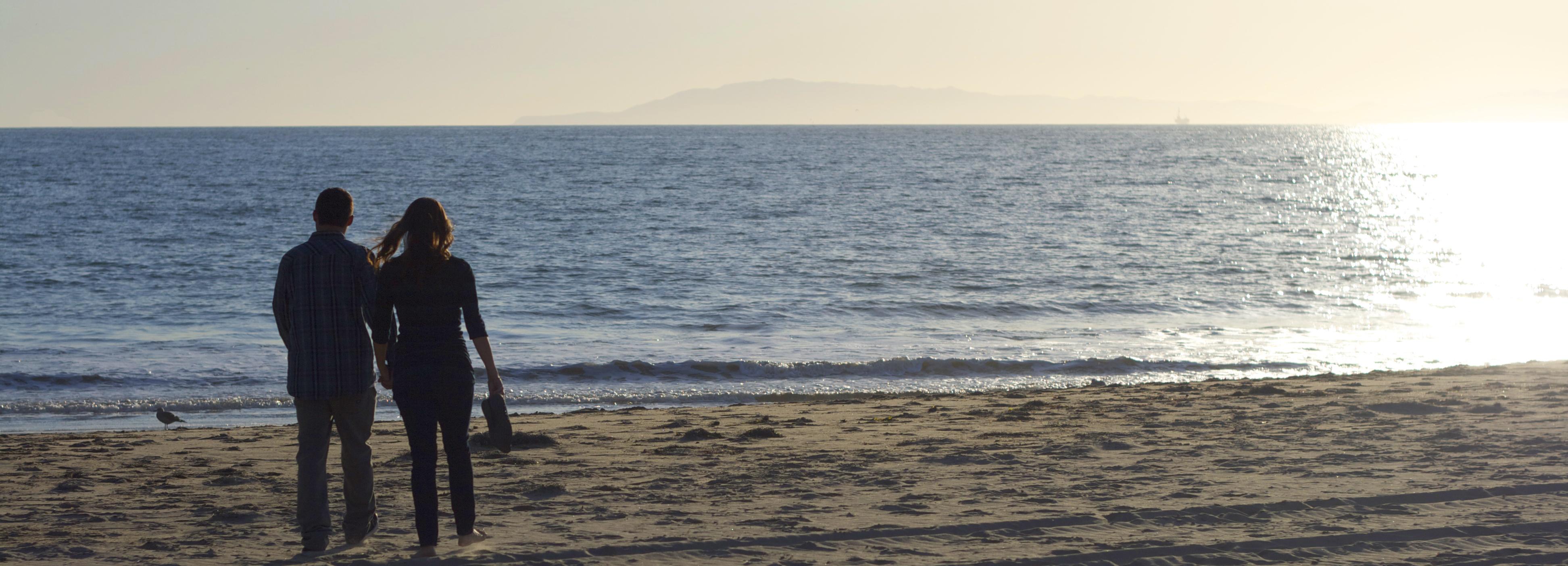 Lindsey and Jason Wilson walking Ventura Beach